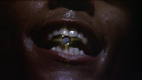 CATCHES BULLETS WITH HIS TEETH