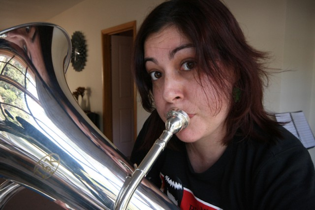 Girl blowing on a euphonium