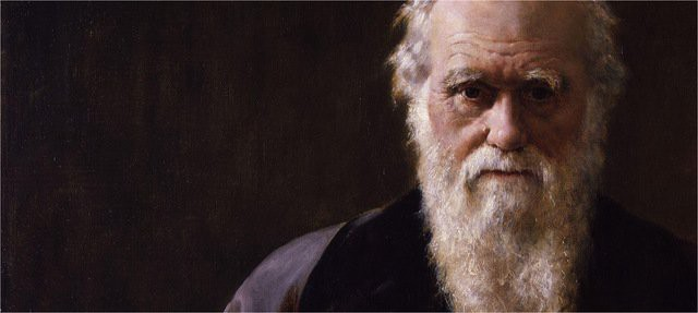 Close-up of a painted portrait of Charles Darwin