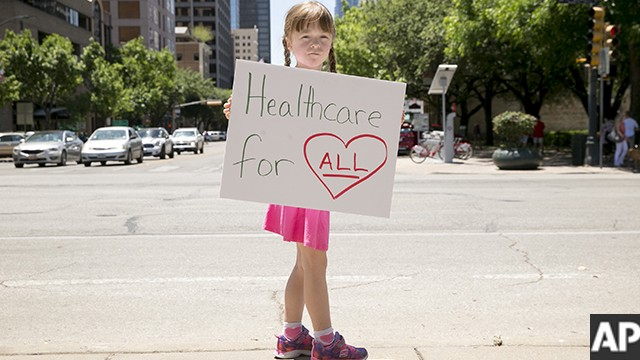 Amari Carter, 5, protests the U.S. House passage of the plan to repeal and replace the Affordable Care Act at the south gate of the Capitol in Austin, Texas, on Friday May 5, 2017. (Jay Janner/Austin American-Statesman via AP)