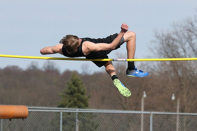 High jumper clearing the bar