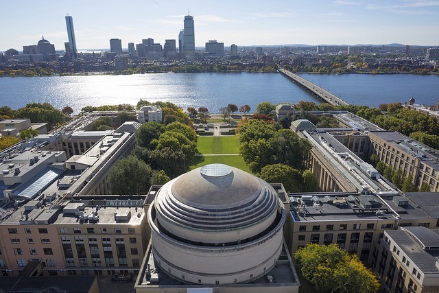 Aerial view of campus from behind MIT dome, looking out over the Charles River to Boston