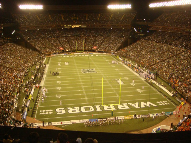 A small football stadium filled with 50,000 people.