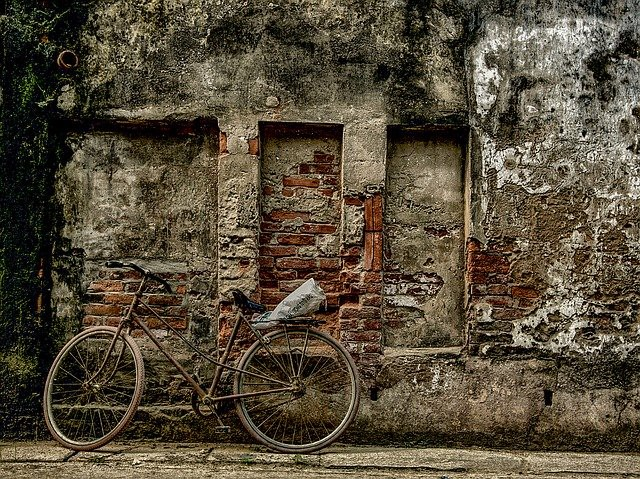 A bicycle rests against a brick wall—how to become freaking frugal and stay that way