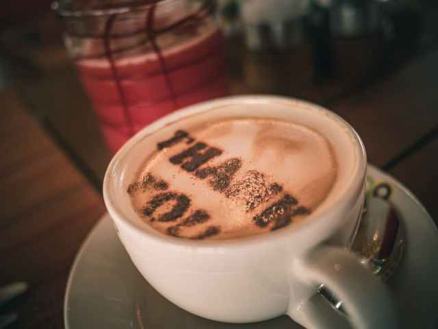 coffee latte with thank you written in the foam