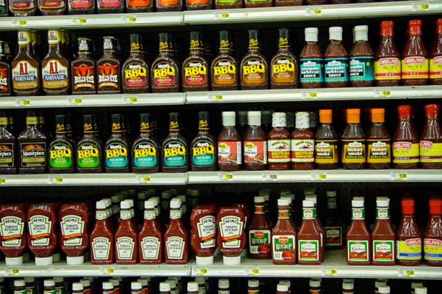 A supermarket shelf with table sauces