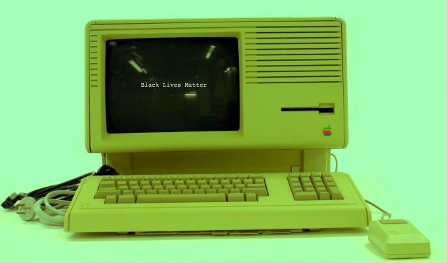 Black Lives Matter words displayed on retro computer.