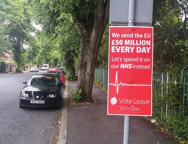 "A sign during the referendum campaign stating, ""We send the EU £50 million every day. Let's spend it on the NHS instead."""