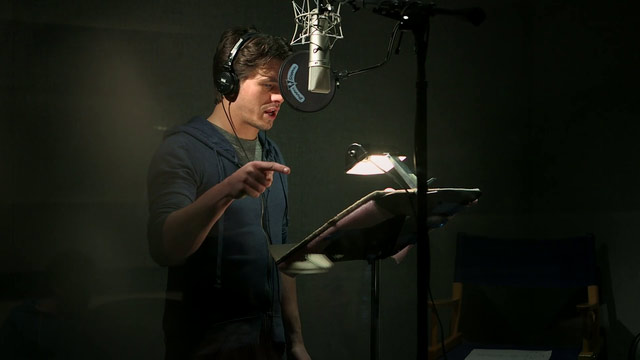 A male voice-talent practicisng his vocal.