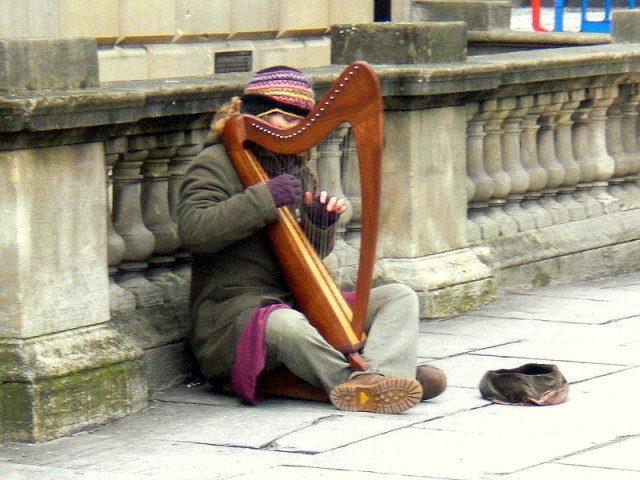 Busker playing a harp