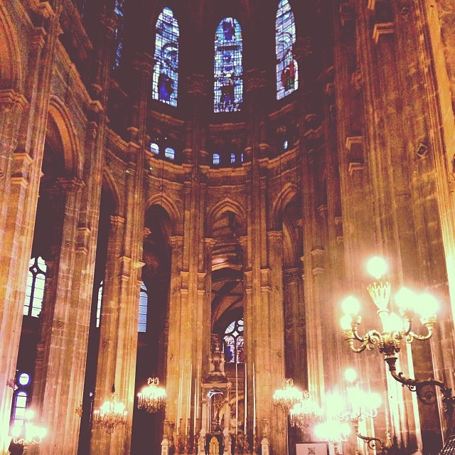The inside of a Parisian cathedral softly lit in the evening