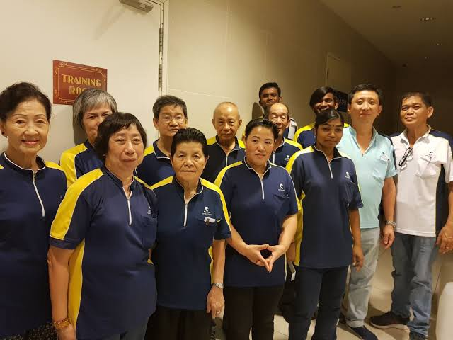a group of elderly Singaporean who works as the office cleaning officer