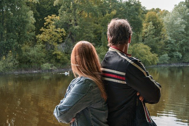 Father and daughter at a lake
