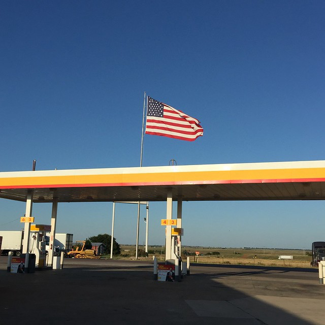 A Texas sized American flag blowing in a Sayre Oklahoma breeze
