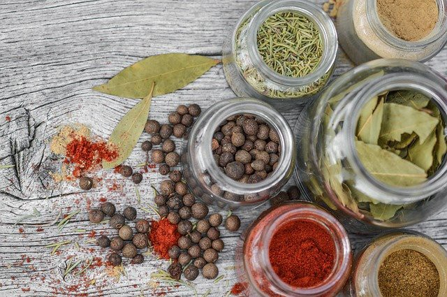 wood, jars with spices and herbs. Need an Increase in Dopamine? How Adaptogens Can Energize and Boost by Nancy Blackman. herbs, herbal medicine, ayurveda, traditional chinese medicine. reishi, mucuna. adaptogen. adaptogens. adaptogenic herbs