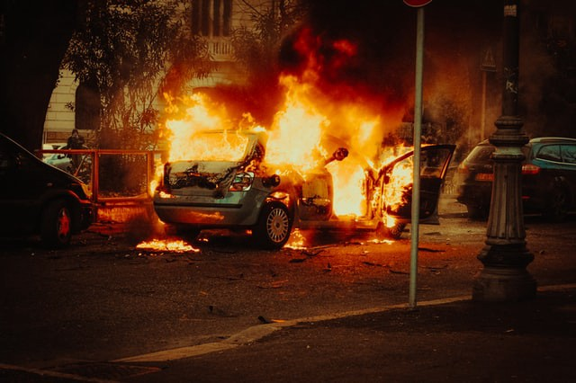Picture of a car burning in the street