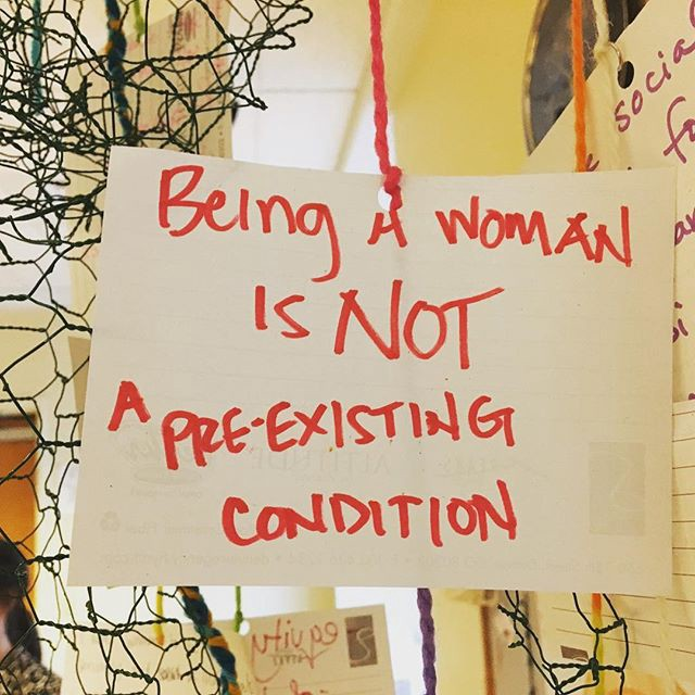 Image: being a woman is not a pre-existing condition
