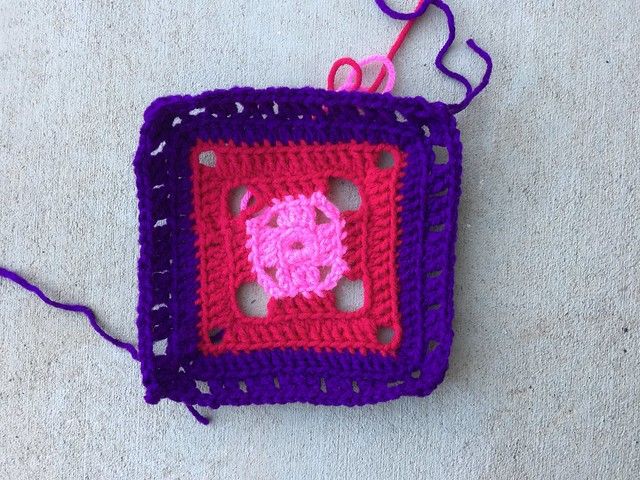 A crochet flamboyant six round granny square worked in three colors