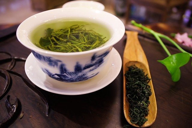 Green tea steeping in a cup