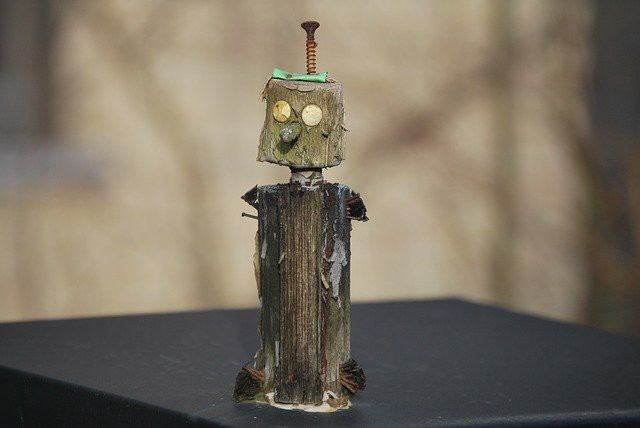 Artwork robot with a screw sticking out of the top of its head.
