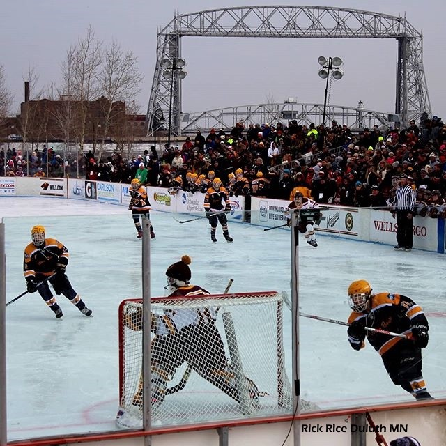 Minnesota Hockey Day. All over the state teams are playing outdoors. As I used to play. Frozen Feet!