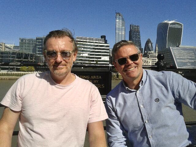 George's friend Mark and George sat down with City of London in background