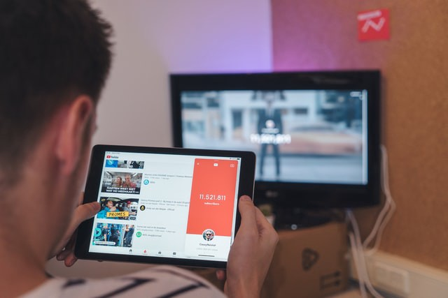 Person watching livestream on tablet.