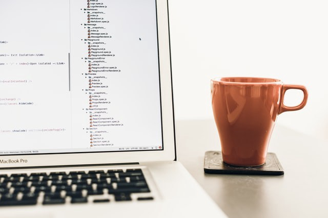 A laptop and a cup. The header image for my article about creating a productivity app from scratch with Python.