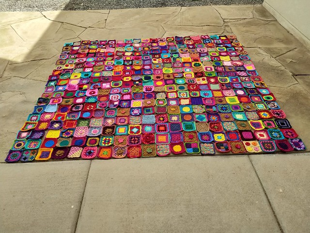 Three hundred-and-sixty five-inch granny squares made from crochet remnants