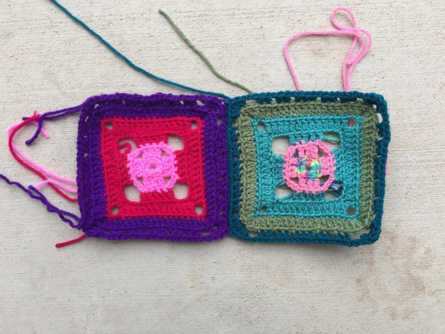 Two flamboyant granny squares with a whip stitch join