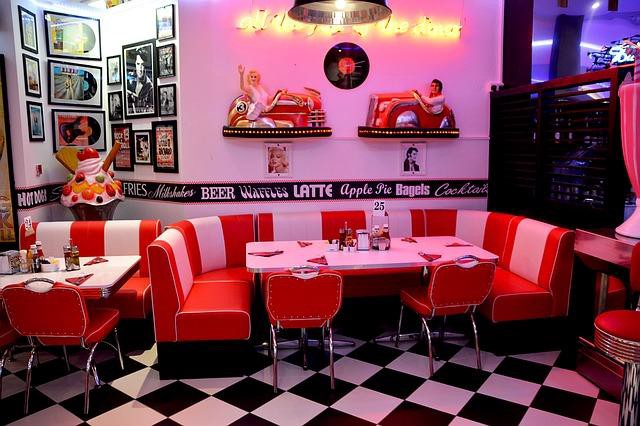 A diner setting with a vinyl round booth.