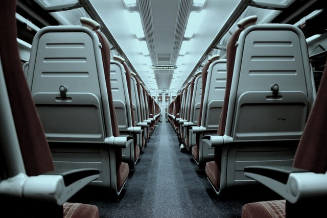 A picture of the inside of an aeroplane showing two rows of seats