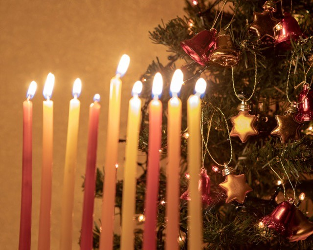 [Menorah in front of Christmas tree]