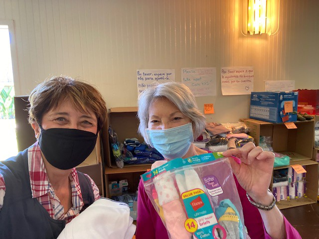 Terry Diehl and Dennie Oades-Souther display underwear and socks given to asylum seekers at the southern boarder.