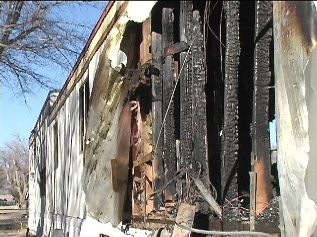 a burnt-out house trailer