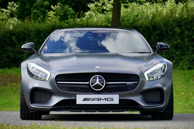 A photo of the front of a Mercedes car.