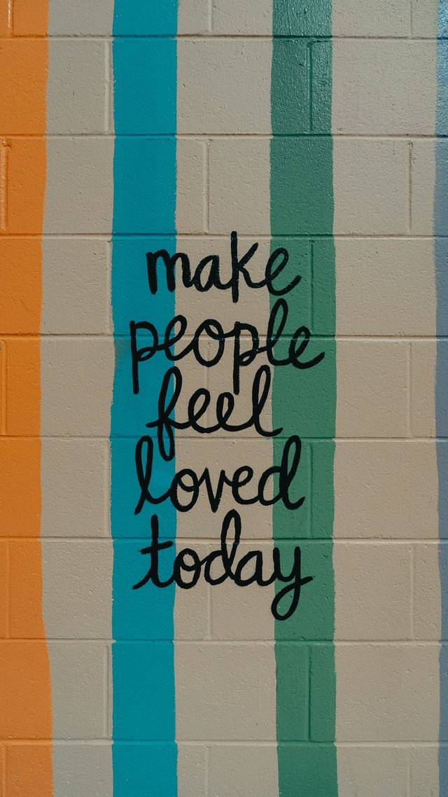 Make People Feel Loved Today, written on a wall