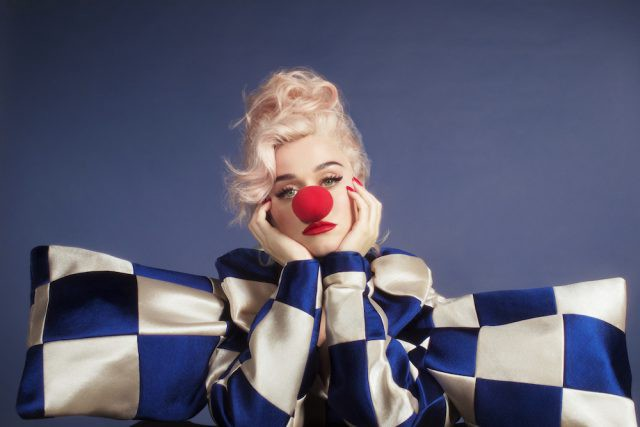 Katy Perry 'Smile' album cover with a checkered blue-and-white shirt and a clown nose.
