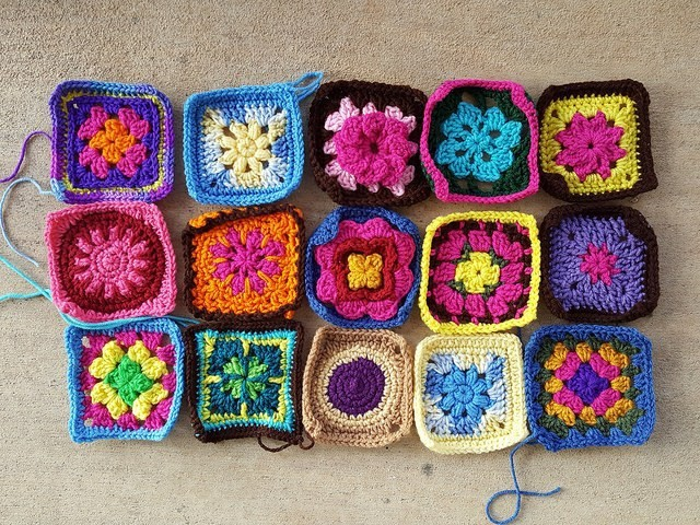 Fifteen crochet squares in formerly assorted sizes rehabbed into five-inch crochet squares