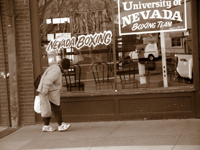 old woman walking on sidewalk