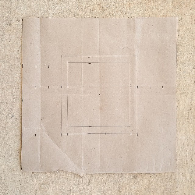 A template made from a brown paper shopping bag