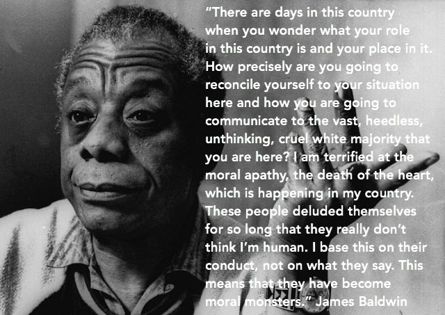 A b&w photo of James Baldwin with a quote in white text.