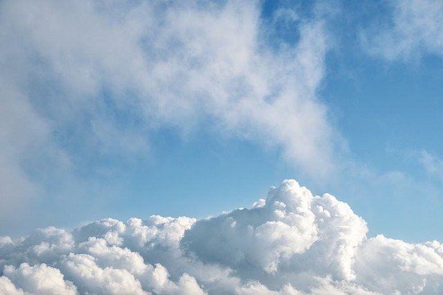 White clouds with blue sky above