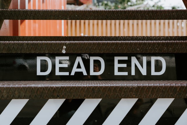 road sign that says Dead End in large letters