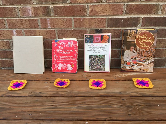 Four crochet books with four different granny square patterns
