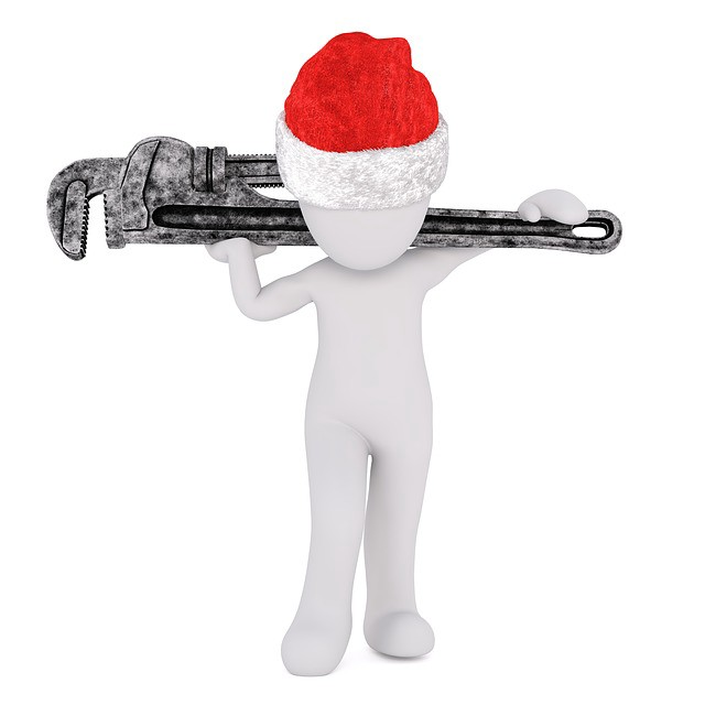 Naked white model human figure with santa hat on and pipe wrench over its shoulders.