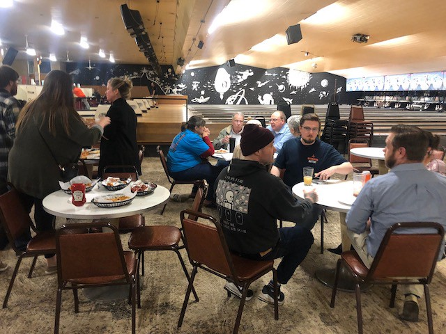 People congregate and share story ideas with the Mahoning Matters staff at Westside Bowl in Youngstown on October 24.