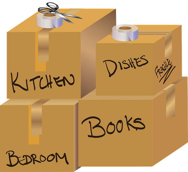 "Cardboard moving boxes with labels for individual rooms (""Kitchen"", ""Books"", ""Dishes"")"