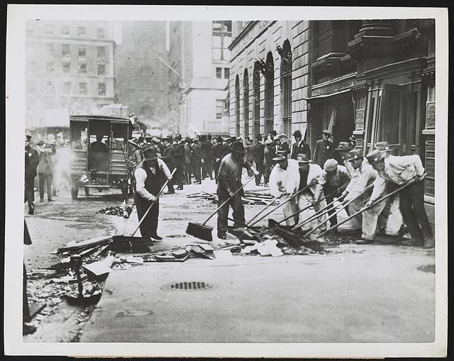 Sweeping Up Broken Glass After Wall Street Bombing (Public Domain: Library of Congress)