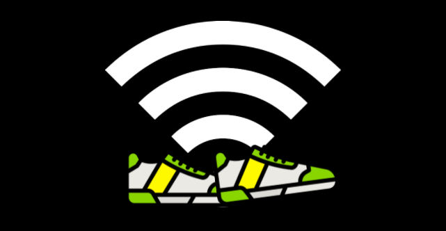 Green, white and yellow sneakers walking in front of a connectivity signal at full strength